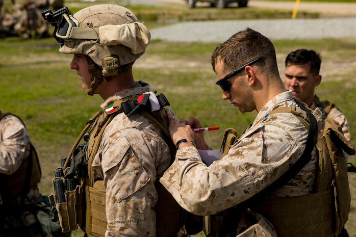 A Marine with 2nd Maintenance Battalion, 2nd Marine Logistics Group marks coordinates on a map during a super squad competition aboard Camp Lejeune, N.C., April 17, 2014. The coordinates represented different stations, where each squad was required to complete a challenge. (U.S. Marine Corps photo by Cpl. Shawn Valosin)