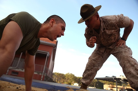 Staff Sgt. Brian Sixto, a drill instructor for Platoon 3034, encourages Rct. Edgar Barua-Gomez, Platoon 3034, Mike Company, 3rd Recruit Training Battalion, to respond to orders March 12, 2014, during an incentive training session on Parris Island, S.C. Discipline, defined as the instant and willing obedience to all orders, respect for authority and self-reliance, is a key trait drill instructors like Sixto, 28, from Hobson, Texas, must instill in recruits. Barua-Gomez, 23, from Kensington, Md., is scheduled to graduate May 23, 2014. Parris Island has been the site of Marine Corps recruit training since Nov. 1, 1915. Today, approximately 20,000 recruits come to Parris Island annually for the chance to become United States Marines by enduring 13 weeks of rigorous, transformative training. Parris Island is home to entry-level enlisted training for 50 percent of males and 100 percent of females in the Marine Corps. (Photo by Cpl. Caitlin Brink)