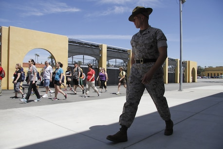"Staff Sgt. Theodoor A. Steber, a drill instructor, marches educators during the Educators' Workshop at Marine Corps Recruit Dept San Diego April 8, 2014. The educators were instructed on the proper response to common terms during recruit training, such as ""eyeballs"" and ""ears."""