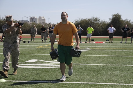 Eric C. McDowell, a Lafayette High School football and basketball coach, carries ammo cans during a portion of the Combat Fitness Test during the Educators' Workshop at Marine Corps Recruit Depot San Diego April 8, 2014.