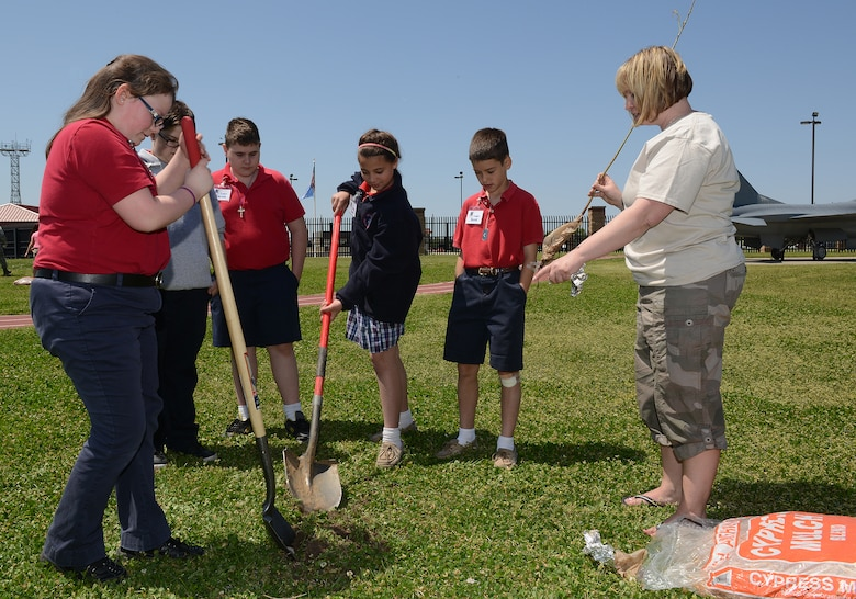 Students from the All Saints Elementary School assist in planting trees at an Earth Day celebration at the 138th Fighter Wing, 22 April 2014.  The 138th FW Environmental Management office organized a cookout and other green activities to celebrate the day at the Tulsa Air National Guard base, Tulsa Okla.  (U.S. National Guard photo by Senior Master Sgt.  Preston L. Chasteen/Released)