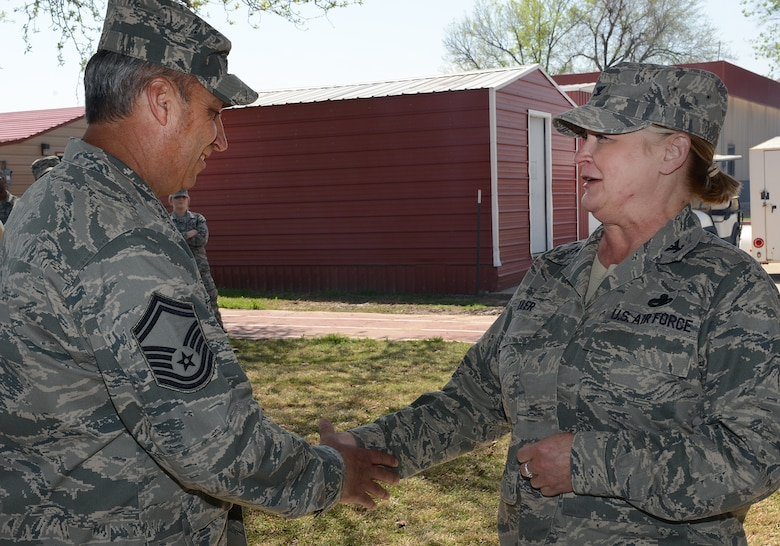 Colonel Rita Miller, 138th Mission Support Group Commander, recognizes Senior Master Sergeant Shawn Strohmeyer for his ESOHCAMP preparation efforts during an Earth Day celebration at the 138th Fighter Wing, 22 April 2014.  The 138th FW Environmental Management office organized a cookout and other green activities to celebrate the day at the Tulsa Air National Guard base, Tulsa Okla.  (U.S. National Guard photo by Senior Master Sgt.  Preston L. Chasteen/Released)