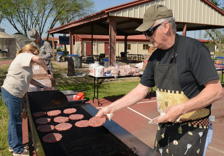 Master Sergeant Don Herbert (Ret.) cooks hamburgers in preparation for Earth Day celebration at the 138th Fighter Wing, 22 April 2014.  The 138th FW Environmental Management office organized a cookout and other green activities to celebrate the day at the Tulsa Air National Guard base, Tulsa Okla.  (U.S. National Guard photo by Senior Master Sgt.  Preston L. Chasteen/Released)