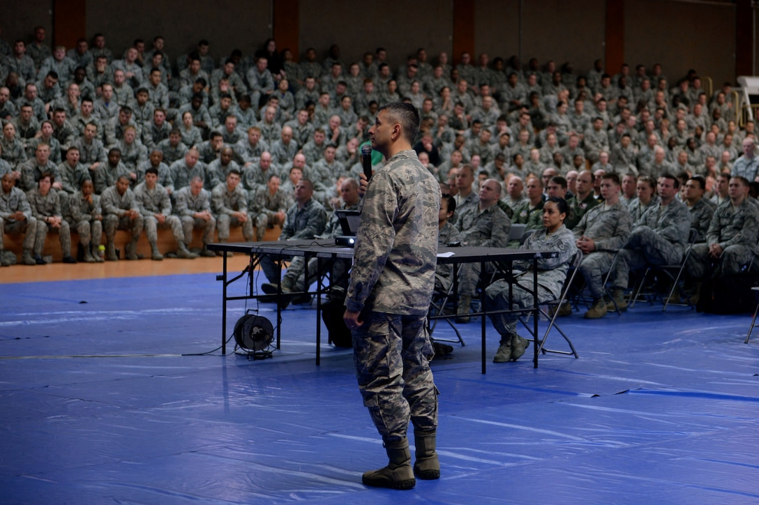 U.S. Air Force Col. David Julazadeh, 52nd Fighter Wing commander, holds an all call at the Skelton Memorial Fitness Center on Spangdahlem Air Base, Germany, April 18, 2014. Julazadeh spoke of stepping in as a bystander and how to identify the behavior of a potential perpetrator. (U.S. Air Force photo by Senior Airman Alexis Siekert/Released)