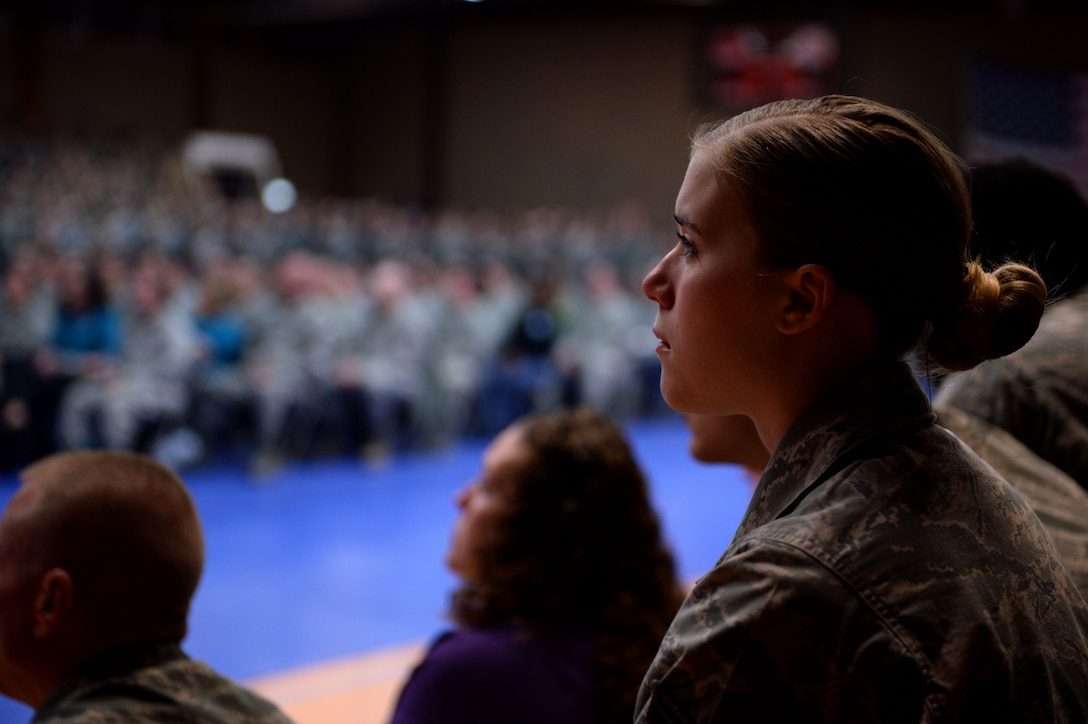 U.S. Air Force Airman 1st Class Alissa Rogers, a 52nd Force Support Squadron food shift leader from Medford, Minn., watches a video on sexual assault during an all call at the Skelton Memorial Fitness Center on Spangdahlem Air Base, Germany, April 18, 2014. The Sexual Assault Prevention and Response down day served as the first of two on ridding the Air Force of sexual assault. The wing will participate in a second down day this fall. (U.S. Air Force photo by Senior Airman Alexis Siekert/Released)