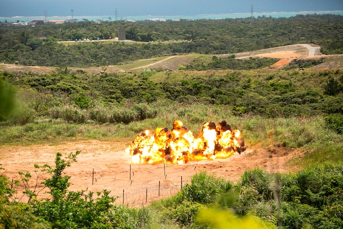A ring of TNT explodes April 15 during a four-day basic demolition training course at Camp Schwab. The controlled explosion allowed Marines to observe how effectively the blast demolished obstacles. The Marines participating in the training are with various units assigned to III Marine Expeditionary Force.