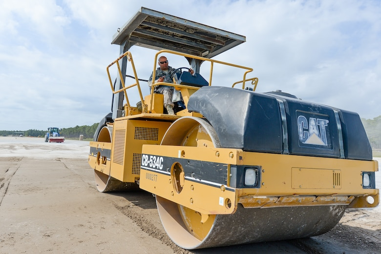 U.S. Air Force Senior Airman Abdel Rodriguez, a heavy equipment operator with the 116th Civil Engineering Squadron (CES), Georgia Air National Guard (ANG), Robins Air Force Base, Ga., drives a vibratory smooth drum roller while repairing a crater on the airfield at Silver Flag training at Tyndall Air Force Base, Fla., April 17, 2014. During the weeklong course, Guardsmen from the 116th CES along with 219 Airmen from multiple U.S. Air Force active duty, Reserve and Air National Guard units trained on building and maintaining bare-base operations at a simulated forward-deployed location. In addition, they honed their combat and survival skills, repaired simulated bomb-damaged runways, practiced EOD scenarios, set up base facilities and established various critical base operating support capabilities. Thirty-four Airmen from the 116th CES attended the exercise that consisted of extensive classroom and hands-on training culminating in an evaluation of learned skills on the last day of class. (U.S. Air National Guard photo by Master Sgt. Roger Parsons/Released)