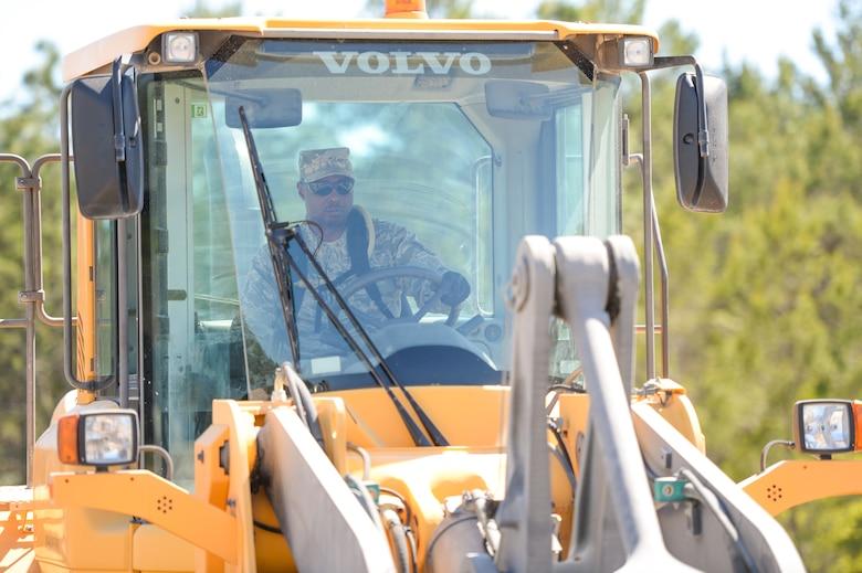 U.S. Air Force Staff Sgt. Marquette Davis, a heavy equipment operator with the 116th Civil Engineering Squadron (CES), Georgia Air National Guard, Robins Air Force Base, Ga., operates a front loader during Silver Flag training at Tyndall Air Force Base, Fla., April 16, 2014. During the weeklong course, Guardsmen from the 116th CES along with 219 Airmen from multiple U.S. Air Force active duty, Reserve and Air National Guard units trained on building and maintaining bare-base operations at a simulated forward-deployed location. In addition, they honed their combat and survival skills, repaired simulated bomb-damaged runways, set up base facilities and established various critical base operating support capabilities. Thirty-four Airmen from the 116th CES attended the exercise that consisted of extensive classroom and hands-on training culminating in an evaluation of learned skills on the last day of class. (U.S. Air National Guard photo by Master Sgt. Roger Parsons/Released)