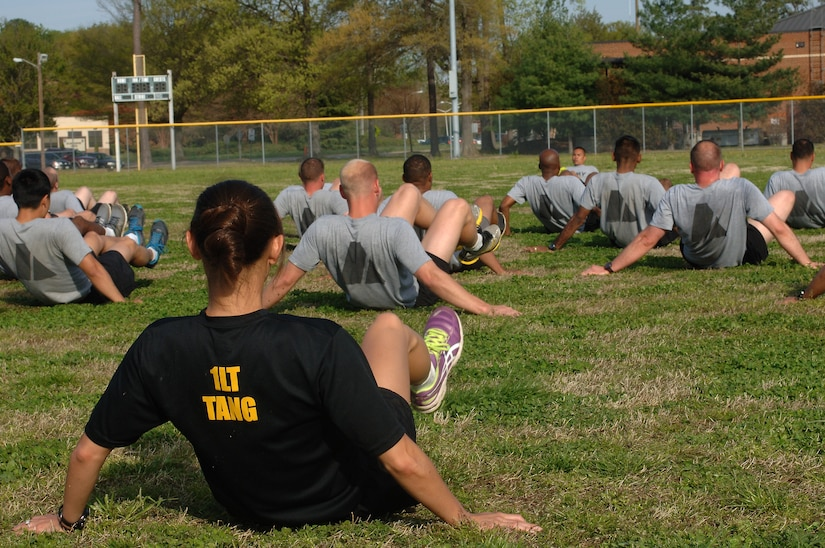 U.S. Army 1st Lt. Amy Tang, U.S. Army Physical Fitness School Mobile Training Team 6 leader, performs v-ups during a group physical training session at Fort Eustis, Va., April 22, 2014. Mobile training teams from the USAPFS travel to various installations to train drill sergeants, Advanced Individual Training platoon sergeants and other cadre to conduct PRT activities. (U.S. Air Force photo by Senior Airman Teresa J.C. Aber/Released)
