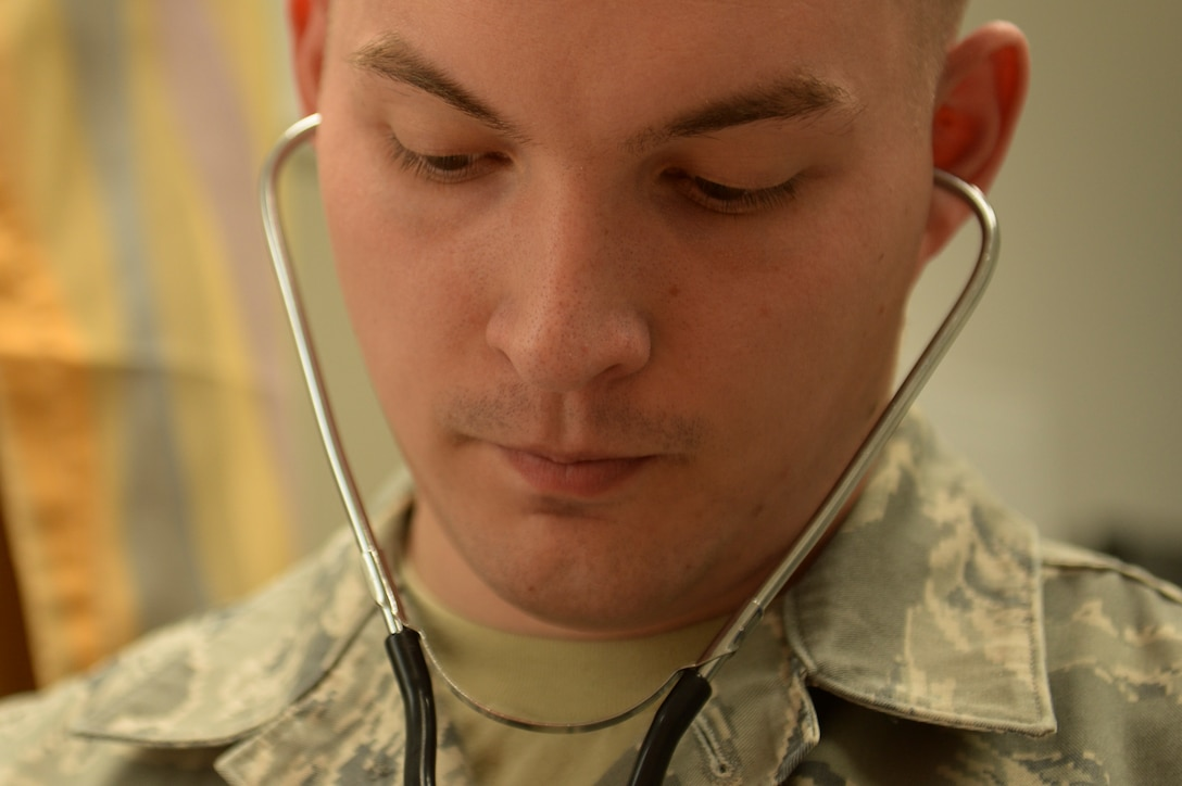 U.S. Air Force Airman 1st Class Samuel Purser, a 52nd Medical Operations Squadron aerospace medical technician from Fayetteville, Ark., takes a patient's blood pressure inside the family health clinic April 22, 2014, at Spangdahlem Air Base, Germany. Members of the family health clinic see more than 20 patients a day. (U.S. Air Force photo by Senior Airman Rusty Frank/Released)