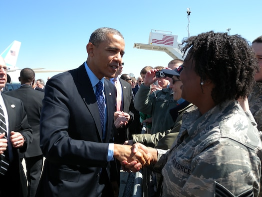 Pennsylvania Air National Guard Staff Sgt. Michaela Diallo shakes President Obama's hand when Obama and Vice President Biden land at the 171st Air Refueling Wing near Pittsburgh Pennsylvania, April 16, 2014. Before Obama Biden leave for their tour of the Community College of Allegheny County West Hills Center to speak on the importance of jobs-driven skills training, Obama and Biden took time to shake hands with members of the 171st Air Refueling Wing. (U.S. Air National Guard Photo/Released)