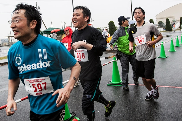 Japanese participants of the 2014 Kintai Marathon, which took place aboard Marine Corps Air Station Iwakuni, Japan, cross the finish line after running a half-marathon, April 13. The Kintai Marathon is one of the few annual events that give Japanese citizens an opportunity to come aboard station. Approximately 800 people signed up for the full marathon, half marathon and five-kilometer walk.