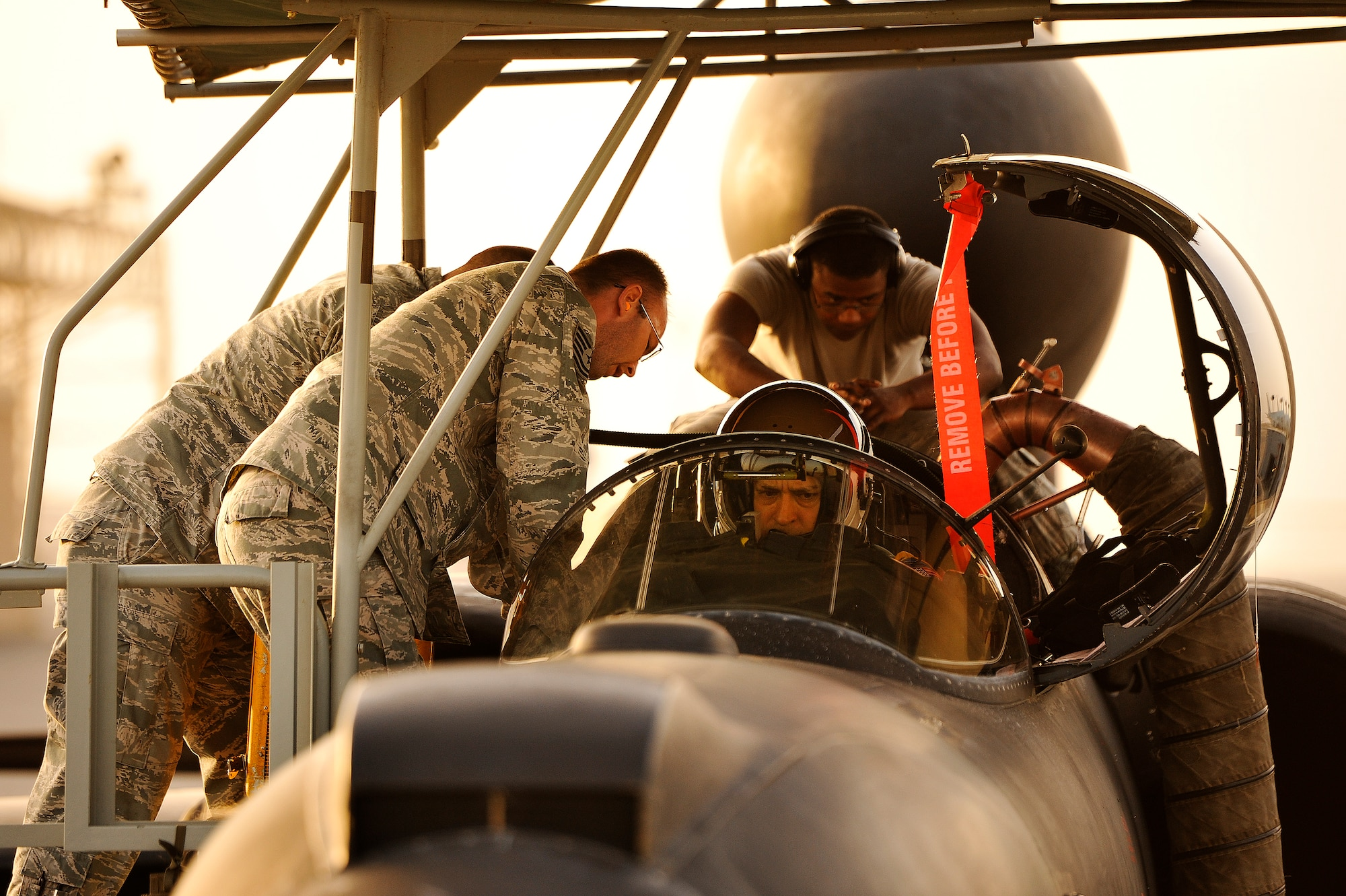 Airmen with the 99th Expeditionary Reconnaissance Squadron integrate Lt. Col. Jeff Klosky into his U-2 Dragon Lady April 20, 2014, at a flightline in Southwest Asia. U-2 pilots need additional help boarding the their aircraft because of their full pressure suits. (U.S. Air Force photo/Tech. Sgt. Russ Scalf)