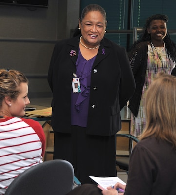 Angela P. Morton, Huntsville Center's Equal Employment Opportunity (EEO) chief, learns about new employees as she leads EEO training for new hires in April 2014. Stephanie Caldwell, in the background, is the center's EEO complaints manager.