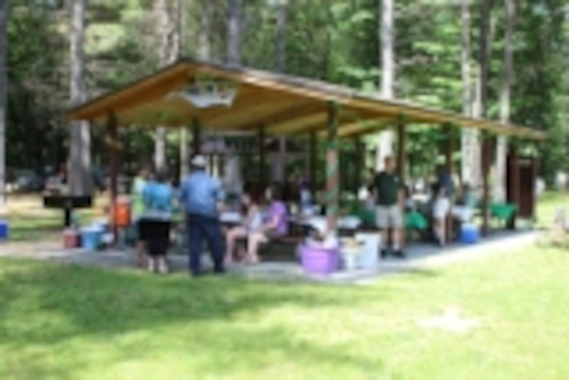 The Davis shelter at Townshend Lake, Townshend, Vt., where picnickers can dine in shady woods or take advantage of our covered picnic shelters. Shelters can be reserved, for a fee, for large gatherings such as family reunions or weddings. Grills are provided at the shelters, with playground equipment, horseshoe pits, and restrooms nearby.
