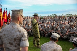 Marines with Marine Rotational Force – Darwin form around Brig. Gen. John Frewen, 1st Brigade commanding general and senior Australian Defence Force officer for Robertson Barracks, to listen to him speak about the six-month rotation, expectations and the significance of their presence, April 11. Frewen said the rotation is a tangible sign of the strength between Australia and the United States.
