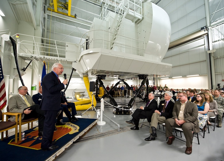 U.S. Representative Randy Neugebauer speaks at the dedication ceremony for the new C-130J Super Hercules simulator April 22, 2014, at Dyess Air Force Base, Texas. Dyess is the first installation to receive this modern C-130J simulator with Vital-10 technology. Vital-10 is an advanced visual display package with a higher resolution and a more realistic display. System benefits include the ability to accomplish initial and recurring qualifications for missions, such as the Joint Precision Airdrop System and Heavyweight Assault Landings. (U.S. Air Force photo/Staff Sgt. Richard Ebensberger)