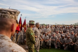 Lt. Col. Keven Matthews, commanding officer of Marine Rotational Force – Darwin, orders the Marines to chant the battalion war cry 'Geronimo', for Brig. Gen. John Frewen, 1st Brigade commanding general and senior Australian Defence Force officer for Robertson Barracks, after he spoke about the six-month rotation, expectations and the significance of their presence, April 11. Frewen said the rotation is a tangible sign of the strength between Australia and the United States.
