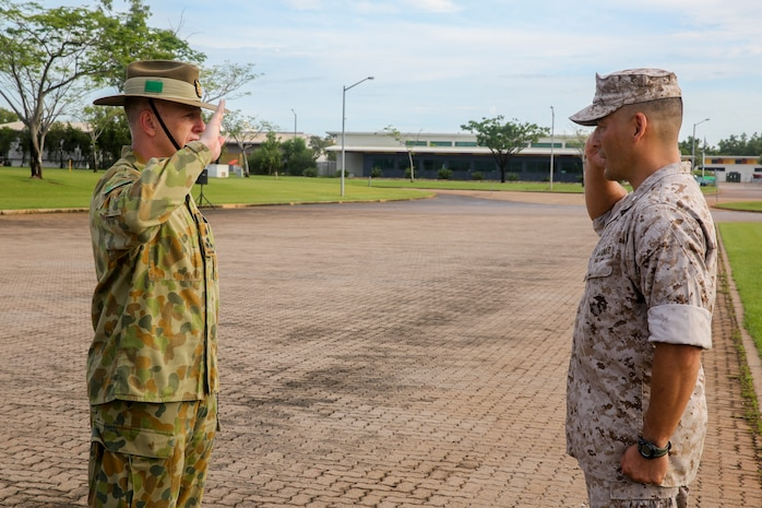 Lt. Col. Keven Matthews, commanding officer of Marine Rotational Force – Darwin, and Brig. Gen. John Frewen, 1st Brigade commanding general and senior Australian Defence Force officer for Robertson Barracks, salute one another after Frewen addresses the Marines of MRF-D about expectations for the rotation, April 11. Frewen said the rotation is a tangible sign of the strength between Australia and the United States.