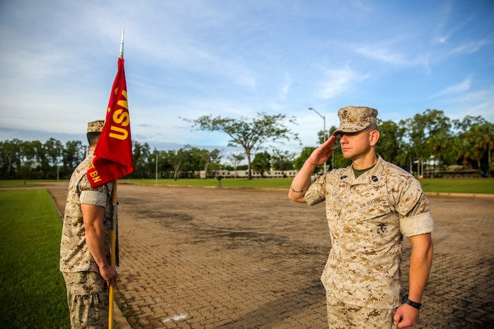 Sgt. Maj. Rogelio De Leon, sergeant major of Marine Rotational Force – Darwin, salutes company commanders, assuring full attendance in anticipation of a speech by Brig. Gen. John Frewen, 1st Brigade commanding general and senior Australian Defence Force officer for Robertson Barracks, about the six-month rotation, expectations and the significance of their presence, April 11. Frewen said the rotation is a tangible sign of the strength between Australia and the United States.