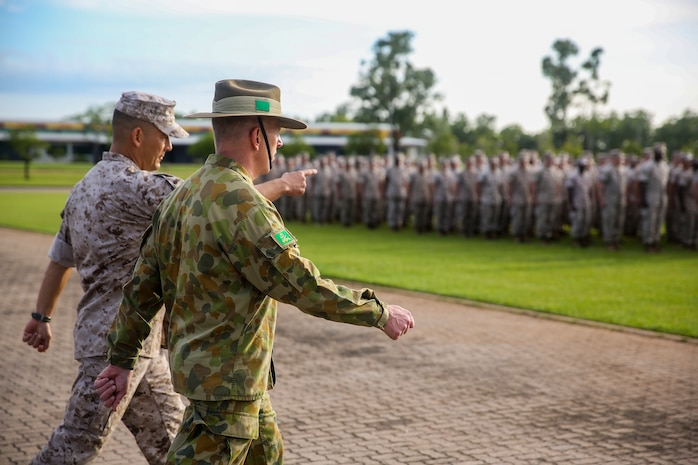 Lt. Col. Keven Matthews, commanding officer of Marine Rotational Force – Darwin, and Brig. Gen. John Frewen, 1st Brigade commanding general and senior Australian Defence Force officer for Robertson Barracks, approach the battalion together before Frewen addresses MRF-D Marines about the six-month rotation, expectations and the significance of their presence, April 11. Frewen said the rotation is a tangible sign of the strength between Australia and the United States.