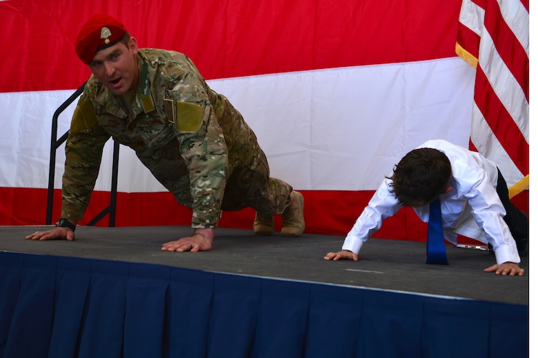 U.S. Air Force Maj. Michael Jensen, 26th Special Tactics Squadron commander, completes memorial pushups during a squadron activation ceremony, April 24, 2014 at Cannon Air Force Base, N.M. The 26 STS, formerly Detachment 1 of the 720th Special Tactics Group, Hurlburt Field, Fla., is a newly activated squadron based at Cannon. (U.S. Air Force photo/ Senior Airman Eboni Reece)