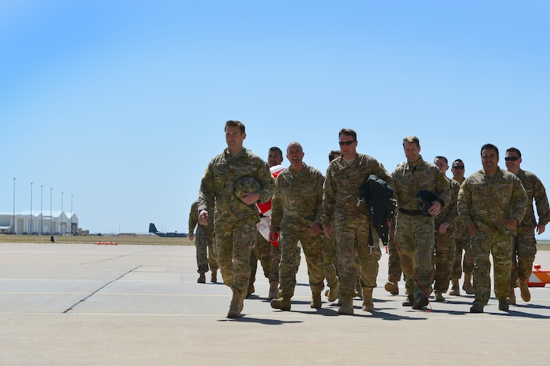 Members of the 26th Special Tactics Squadron walk across the flightline prior to a squadron activation ceremony, April 24, 2014 at Cannon Air Force Base, N.M. The 26 STS, formerly Detachment 1 of the 720th Special Tactics Group, Hurlburt Field, Fla., is a newly activated squadron based at Cannon. (U.S. Air Force photo/ Senior Airman Eboni Reece)