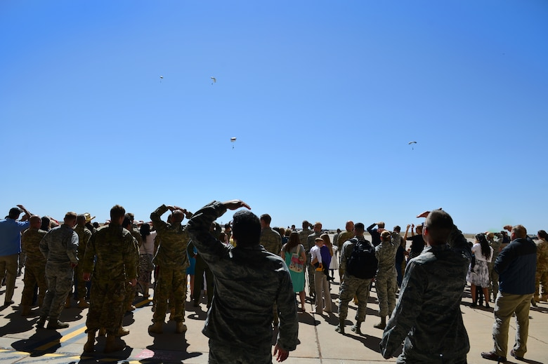 Spectators watch as members of the 26th Special Tactics Squadron parachute onto the flightline, April 24, 2014 at Cannon Air Force Base, N.M. The 26 STS, formerly Detachment 1 of the 720th Special Tactics Group, Hurlburt Field, Fla., is a newly activated squadron based at Cannon. (U.S. Air Force photo/ Senior Airman Eboni Reece)