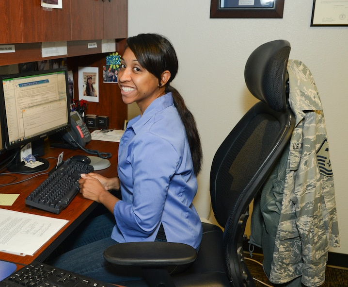Master Sgt. Olypia Williamson, 1st Sgt.,136th Airlift Wing, works on her computer while wearing jeans in observance of 'Denim Day', a campaign observed annually on April 23 for the awareness of sexual assault prevention and response  at Naval Air Station Fort Worth Joint Reserve Base, Texas, April 23, 2014. This occasion marks the last event of the Sexual Assault Awareness Month in the Wing. (U.S. Air National Guard photo by Senior Master Sgt. Elizabeth Gilbert/Released)