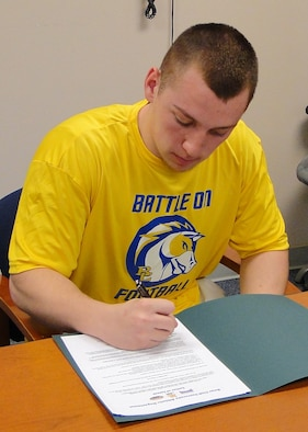 Tyler Wright, Cienega High School Bobcats defensive tackle, signs a letter of intent to play football at Briar Cliff University, located in Sioux City, Iowa. Tyler, son of Maj. Shannen M. Wright, 355th Medical Operations Squadron, suffered a torn anterior cruciate ligament in his right knee and was treated by the 355th Medical Group at Davis-Monthan Air Force Base, Ariz.(Courtesy Photo)