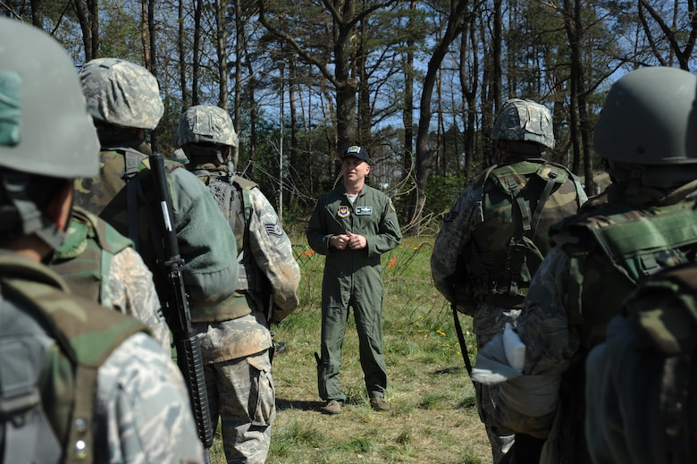 U.S. Air Force Col. Robert Winkler, 52nd Operations Group commander, speaks to Airmen going through a combat readiness training exercise April 17, 2014, at Spangdahlem Air Base, Germany.  Daily training along with CRT helps the 606th Air Control Squadron stay deployment-ready.  (U.S. Air Force photo by Airman 1st Class Dylan Nuckolls/Released)
