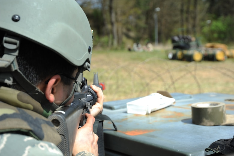 A U.S. Air Force Airman from the 606th Air Control Squadron performs entry control point duty during a combat readiness training exercise April 18, 2014, at Spangdahlem Air Base, Germany.  Airmen on ECP duty performed searches on individuals who wanted to gain entrance to the base. (U.S. Air Force photo by Airman 1st Class Dylan Nuckolls/Released)