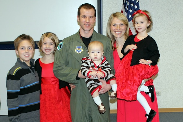 U.S. Air Force Maj. Bradley Sullivan, 480th Fighter Squadron F-16 Fighting Falcon pilot, Spangdahlem Air Base, Germany, stands with his wife Jenny and their four children in 2014, including his daughter Chloe (pictured far right). Both Jenny and Sullivan lost their first spouses to cancer and were single parents until they married in 2011. (Courtesy Photo/Released)