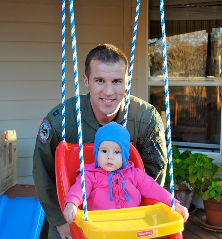 U.S. Air Force Maj. Bradley Sullivan, 480th Fighter Squadron F-16 Fighting Falcon pilot, Spangdahlem Air Base, is pictured here in 2010 with his one-year-old daughter Chloe Grace at a friend's house, near Randolph Air Force Base, Texas. Sullivan was a single parent after his wife Sara passed away from breast cancer, two weeks after giving birth to Chloe. (Courtesy Photo/Released)
