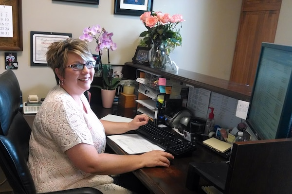 Chrystal McConkey, a regulatory program assistant at the U.S. Army Corps of Engineers Nashville District's Eastern Regulatory Field Office in Lenoir City, Tenn., works at her desk April 25, 2014.  She is the Employee of the Month for March 2014.