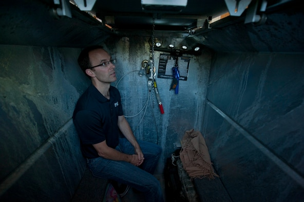 Jeremy Kirk, 82nd Civil Engineering Squadron emergency management specialist, sits down in the tornado shelter at his house April 23, 2014. Kirk helps the 82nd CES formulate escape and preparation plans for natural disasters. (U.S. Air Force photo by Airman 1st Class Jelani Gibson)