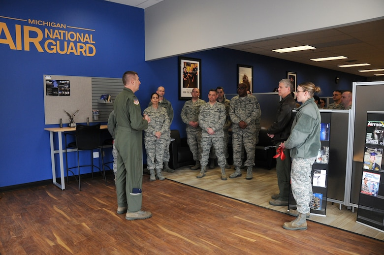 Members of the 110th Airlift Wing, Michigan Air National Guard take part in a ribbon cutting ceremony for the new Air National Guard Career Center and Recruiting Office located in The Shoppes on Stadium in Kalamazoo, Mich., February 22, 2014. The recruiting station educates applicants who are considering the option of military service in the Air National Guard. (U.S. Air National Guard photo by Master Sgt. Sonia Pawloski/Released)
