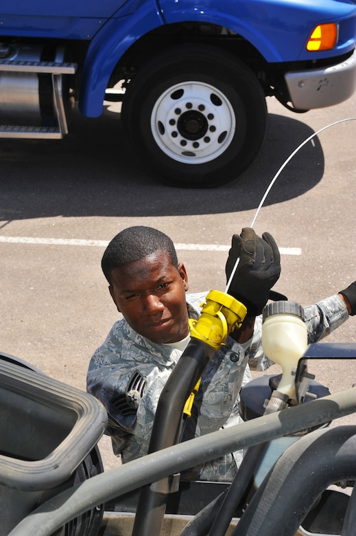 Staff Sgt. Ronald Brooks, 56th Logistics Readiness Squadron vehicle operations craftsman, performs an operations check on a vehicle at Luke Air Force Base, Ariz., April 24, 2014. Brooks lived first hand through Hurricane Katrina which topped out at Catagory 5 strength. (U.S. Air Force photo by Senior Airman Jason Colbert)