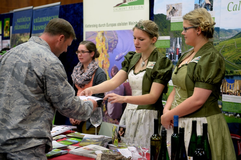 A participant at the 10th Annual Explore the Eifel Info and Adventure Fair learns about wine vineyards in the local area at Club Eifel on Spangdahlem Air Base, Germany, April 24, 2014. Exhibitors offered maps, information and food samples for their areas or businesses. (U.S. Air Force photo by Senior Airman Alexis Siekert/Released)