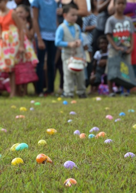 "Children wait for the announcer to yell ""go"" during the base Easter egg hunt April 19, 2014, on Andersen Air Force Base, Guam. The Base Exchange and Andersen Network 5/6 sponsored the event with more than 6,000 eggs for approximately 500 base children. (U.S. Air Force photo by Airman 1st Class Amanda Morris/Released)"