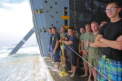 Marines and sailors with Special Purpose Marine Air Ground Task Force Association of Southeast Asian Nations participate in a Swim Call - allowing them to swim in a small area behind the ship, secured by lifeboats and a safety line aboard amphibious transport dock ship USS Anchorage (LPD 23), April 11, 2014. Swimming in the sea, more than a thousand miles away from land, provided the Marines and sailors with a physically intensive but unique experience. The event was one of many recreational events held with SPMAGTF-ASEAN to relieve stress and build unit cohesion. SPMAGTF-ASEAN, aboard Anchorage, recently completed a mission to support U.S. Secretary of Defense Chuck Hagel during a press conference with delegates and media personnel from the ASEAN in Hawaii, April 1-4, 2014 and is currently at sea conducting further training and maintenance on equipment.