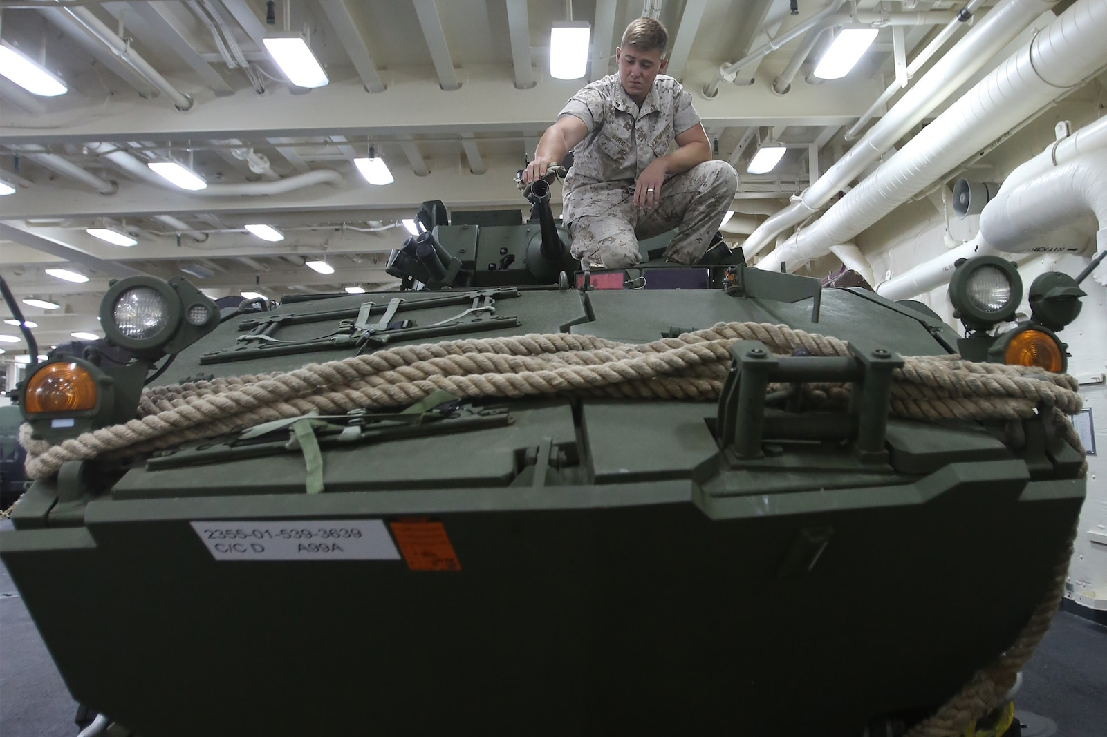Lance Cpl. Jonathan S. Streit, a light armored vehicle crewman with 1st Light Armored Reconnaissance Battalion, 1st Marine Division, cleans the barrel of a 25mm bushmaster chaingun while part of Special Purpose Marine Air Ground Task Force ASEAN, aboard amphibious transport dock ship USS Anchorage (LPD-23), April 15, 2014. As part of SPMAGTF-ASEAN, 1st LAR showcased their territorial defense capabilities alongside units with 1st MLG on their mission to support the U.S. Secretary of Defense Chuck Hagel, during the Association of Southeast Asian Nations press conference in Hawaii, April 1-4, 2014. SPFMAGTF-ASEAN conducted further training at sea starting April 7, 2014. Streit is from Montrose, Colorado. (U.S. Marine Corps photo courtesy of Lance Cpl. Shaltiel Dominguez/ Released)