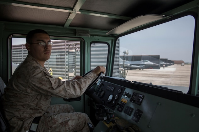 Cpl. Luis Lara, a Semitrailer refueler operator with Marine Wing Support Squadron 171, maneuvers an R-11 aircraft refueling tank truck onto the air strip aboard Gwangju Air Base, Republic of Korea, April 16, 2014, to refuel F-16s with the United States Air Force, 51st Fighter Wing, during Exercise Max Thunder 14-1. In support of the exercise, Marines with MWSS-171 will provide jet fuel for Marine, Navy, And Air Force aircraft.