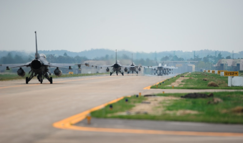 U.S. Navy, Marine Corps and Air Force pilots taxi towards the runway to begin a joint sortie during the 12th Max Thunder April 22, 2014, at Gwangju Air Base, Republic of Korea. The two-week exercise is the air component-led portion of Exercise Foal Eagle and trains both ROK and U.S. Airmen on aerial training. (U.S. Air Force photo by Senior Airman Armando A. Schwier-Morales)