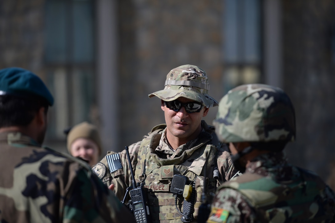 Tech. Sgt. Rafael Melendez debriefs Afghan Air Force airmen following an unexploded explosive ordnance training exercise Feb. 13, 2014 in Kabul, Afghanistan. Security Forces advisory Airmen oversaw the exercise to help advise Afghan air force quick reaction forces on how to respond to possible UXO scenarios. Melendez is a 438th Air Expeditionary Wing/NATO Air Training Command-Afghanistan law enforcement advisor. (U.S. Air Force photo /Tech. Sgt. Jason Robertson)