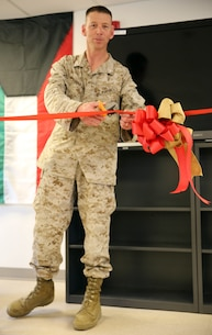 Lieutenant Col. Joel Schmidt, the battalion commander of 2nd Battalion, 2nd Marine Regiment, 2nd Marine Division, cuts a ribbon during a ribbon cutting ceremony held at the battalion command post aboard Marine Corps Base Camp Lejeune, NC, April 25, 2014. Also known as the NCO mess, the lounge is a place where the noncommissioned officers can participate in professional development through discussion, debate and mentorship in an environment that fosters critical thinking and education.