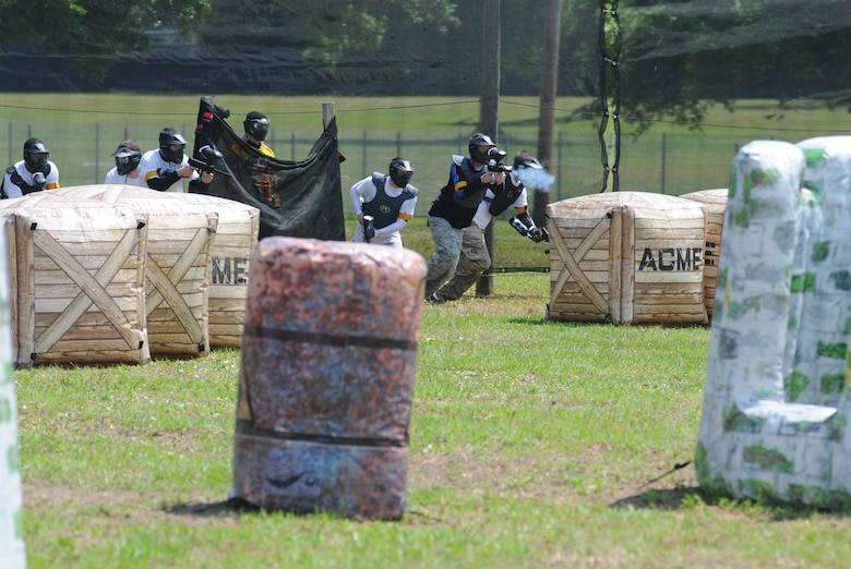 Permanent party Airmen begin a friendly match against the technical training Airmen during the paintball facility grand opening April 25, 2014, southeast of the commissary at Keesler Air Force Base, Miss.  The paintball facility was funded with a portion of the 2013 Commander-in-Chief Installation Excellence award funds.  (U.S. Air Force photo by Kemberly Groue)