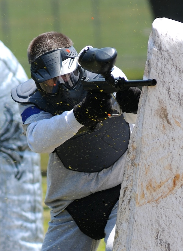 Col. Roland Engel, 81st Diagnostic and Therapeutics Squadron, is fired upon during a friendly match between the Chiefs and the Colonels at the paintball facility grand opening April 25, 2014, southeast of the commissary at Keesler Air Force Base, Miss.  The paintball facility was funded with a portion of the 2013 Commander-in-Chief Installation Excellence award funds.  (U.S. Air Force photo by Kemberly Groue)