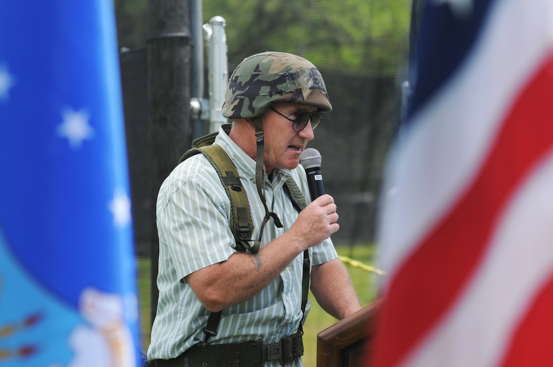 Tom Golden, 81st Force Support Squadron, serves as master of ceremonies, while dressed in combat gear, during the paintball facility grand opening April 25, 2014, southeast of the commissary at Keesler Air Force Base, Miss.  The paintball facility was funded with a portion of the 2013 Commander-in-Chief Installation Excellence award funds.  (U.S. Air Force photo by Kemberly Groue)