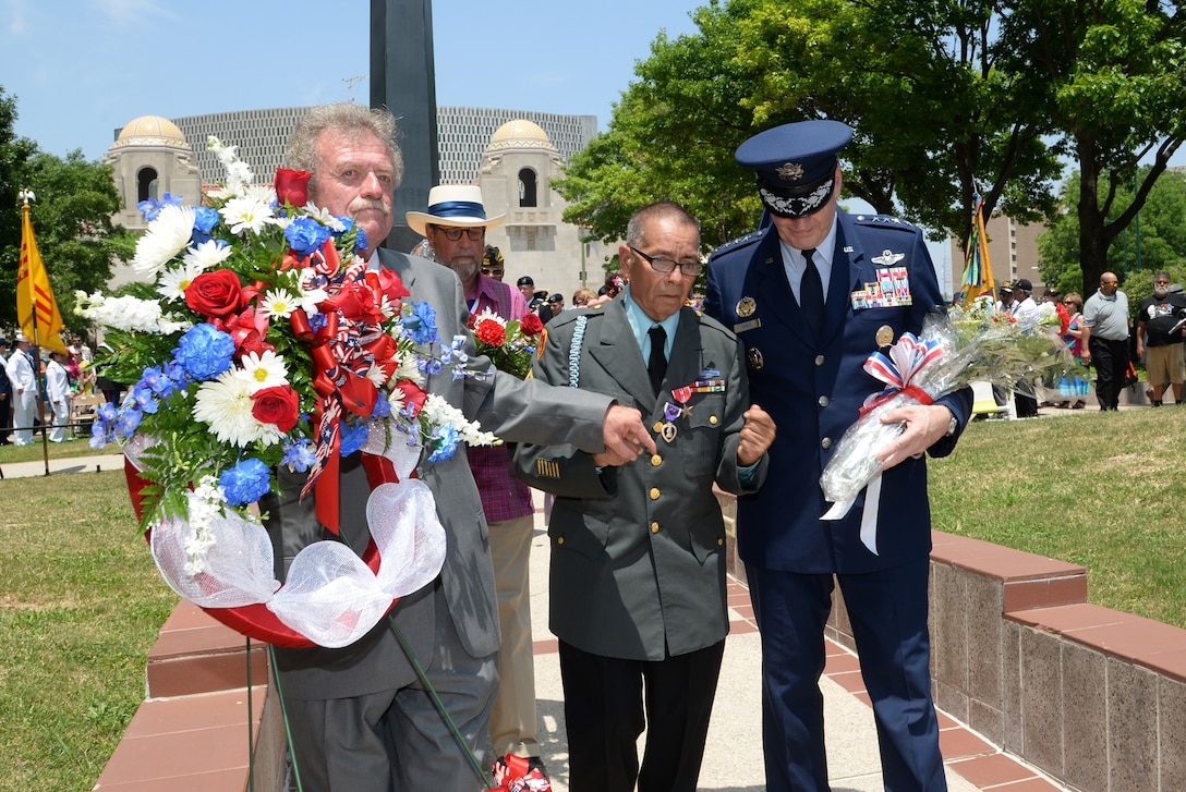Air Force Gen. Robin Rand, Air Education Training and Command commander, participates in laying a floral tribute at the Monument for the Battle of Hill 881 South (with James Fenimore, Alamo Chapter 366 Vietnam Veterans of America commissioner, and Jack Hebdon, Fiesta San Antonio Commission president) during the Fiesta 2014 All Veterans Memorial Service Floral Tribute Procession in Veterans Square, San Antonio. Since 1891, Fiesta events observe the heroes of the Alamo and the Battle of San Jacinto. The Chapter 366 Vietnam Veterans' memorial service honors U.S. military members, past and present, for their dedicated service. All who participated in the floral tribute procession had an opportunity to donate a floral offering during the ceremony. (U.S. Air Force photo by Johnny Saldivar)
